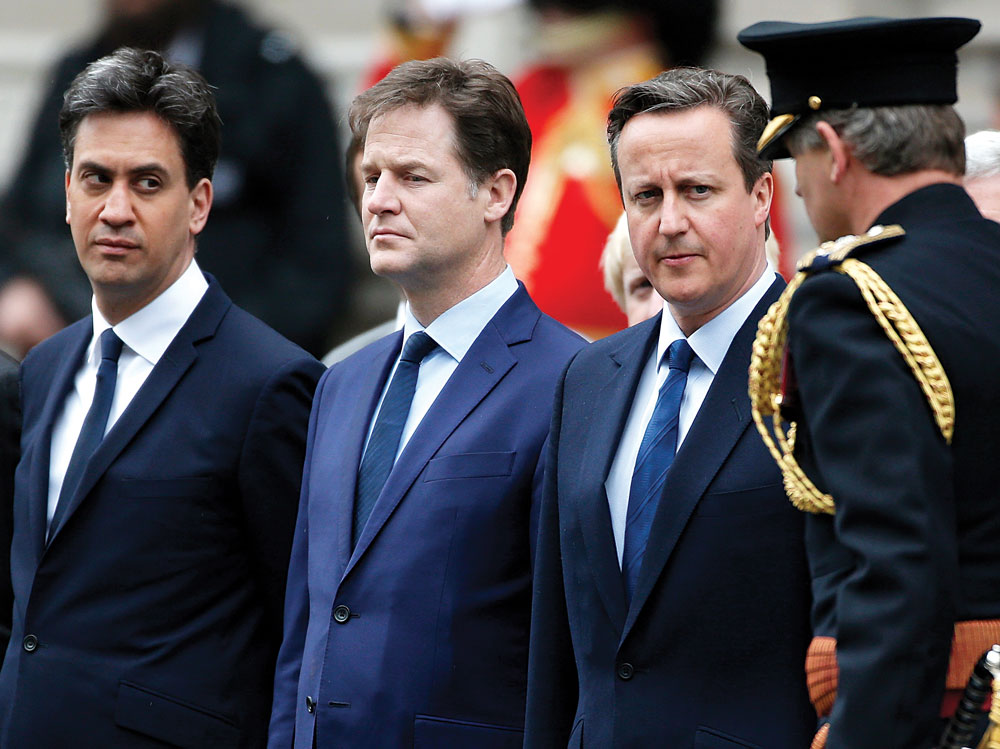 Ed Miliband (L) who today resigned as leader of the Labour Party, Nick Clegg who resigned as leader of the Liberal Democrats, and Britain's Prime Minister David Cameron (2nd R) line up to pay tribute at the Cenotaph to mark the 70th anniversary of VE Day in London, on Friday. (REUTERS/Peter Nicholls)