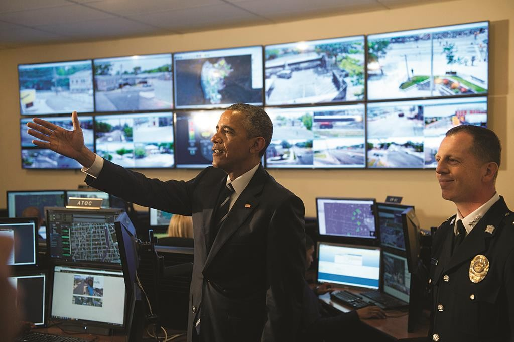 President Barack Obama at the Real-Time Tactical Operational Intelligence Center with Camden County Police Chief J. Scott Thomson on Monday, May 18, 2015.  (Chris LaChall/Camden Courier-Post via AP, Pool)