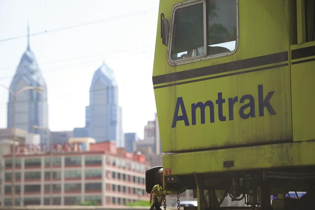 An Amtrak train is parked in Philadelphia on Monday morning. In the background is a view of the skyline near 30th Street Station. Amtrak resumed service on Monday, following last week's derailment. (Mark Makela/Getty Images)
