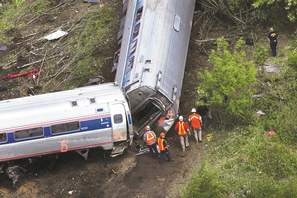 Emergency workers and Amtrak personnel inspect a derailed Amtrak train in Philadelphia, Pennsylvania.  (REUTERS/Lucas Jackson)