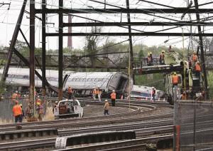 Emergency personnel walk near the scene of a deadly train wreck, Wednesday,  in Philadelphia.  (AP Photo/Mel Evans)