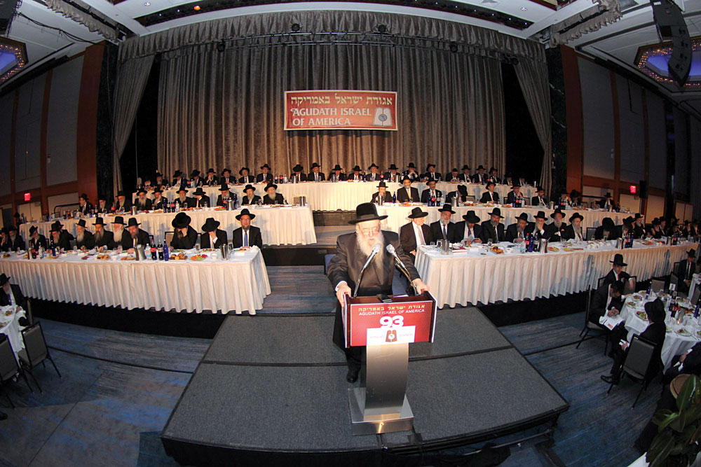 """The Novominsker Rebbe, shlita, addresses the crowd at the annual dinner of Agudath Israel of America, celebrating 93 years of unparalleled growth, at the New York Hilton. More coverage of the dinner will appear, iy""""H, in Hamodia's weekly edition. (Hillel Engel)"""