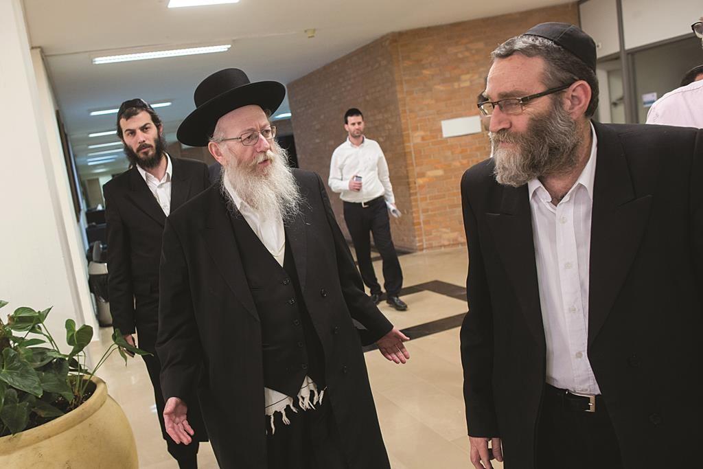 United Torah Judaism MK Rabbi Yaakov Litzman (L) is back at the Health Ministry, and UTJ MK Rabbi Moshe Gafni (R) has returned to his former post as chairman of the Knesset Finance Committee. (Yonatan Sindel/FLASH90)