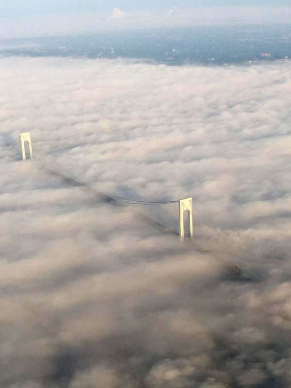 A dense fog and smoke from a brush fire settles Friday over the Verrazano Bridge spanning Brooklyn and Staten Island. (Mike Shapiro/Twitter)