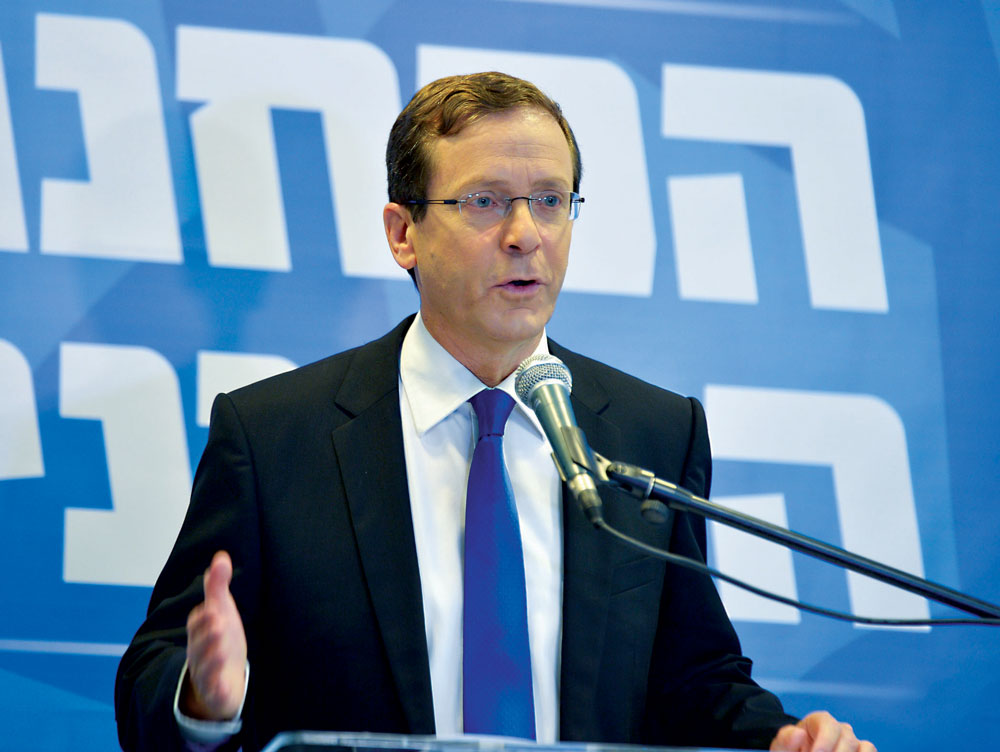 Opposition leader Isaac Herzog speaks at a press conference in Tel Aviv on Thursday. (FLASH90)