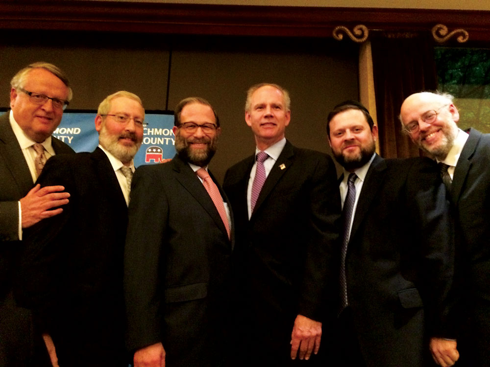 Congressman-elect Dan Donovan poses Tuesday night with leaders of the Flatbush Jewish Community Coalition (L-R): Peter Rabenwurtzel, Josh Mehlman, Leon Goldenberg, Donavan, Chaskel Bennett and Shimon Lefkowitz.