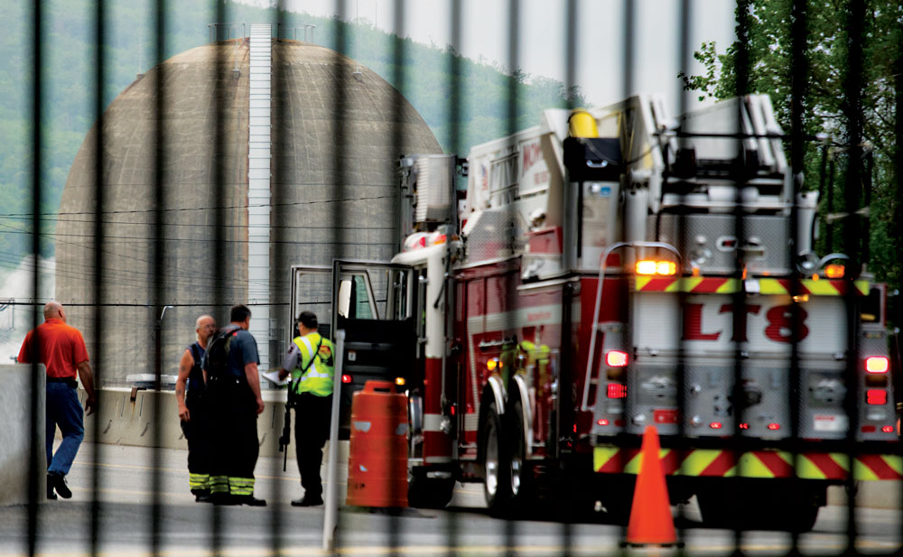 Security and fire personnel move about the Indian Point nuclear power plant Saturday. (AP Photo/Craig Ruttle)