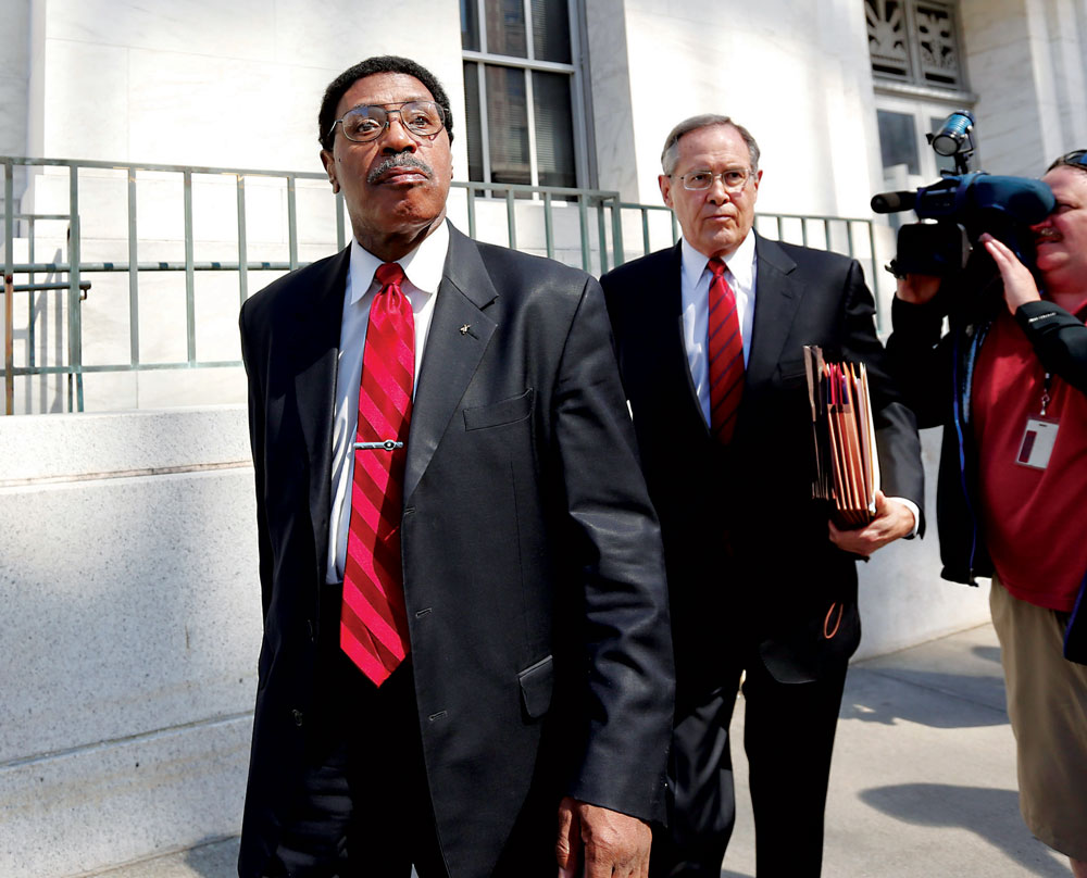 Former Assemblyman William Scarborough (L) on Thursday leaves the federal courthouse in Albany with his attorney. (AP Photo/Mike Groll)