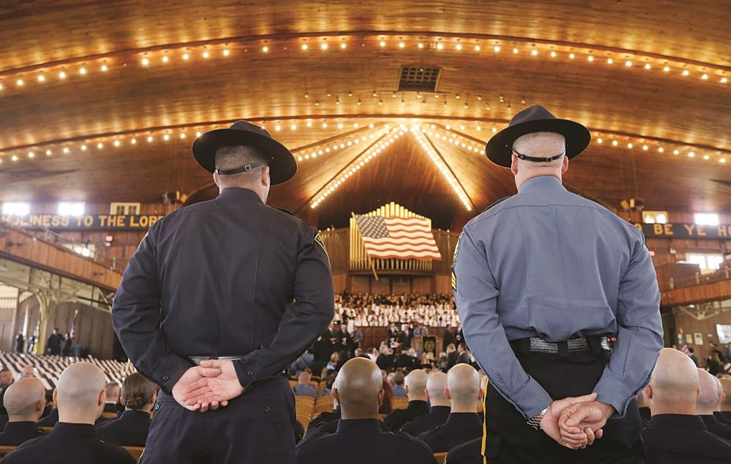 Police officers stand Tuesday during the state's annual memorial service in Ocean Grove's Great Auditorium. (AP Photo/Mel Evans)