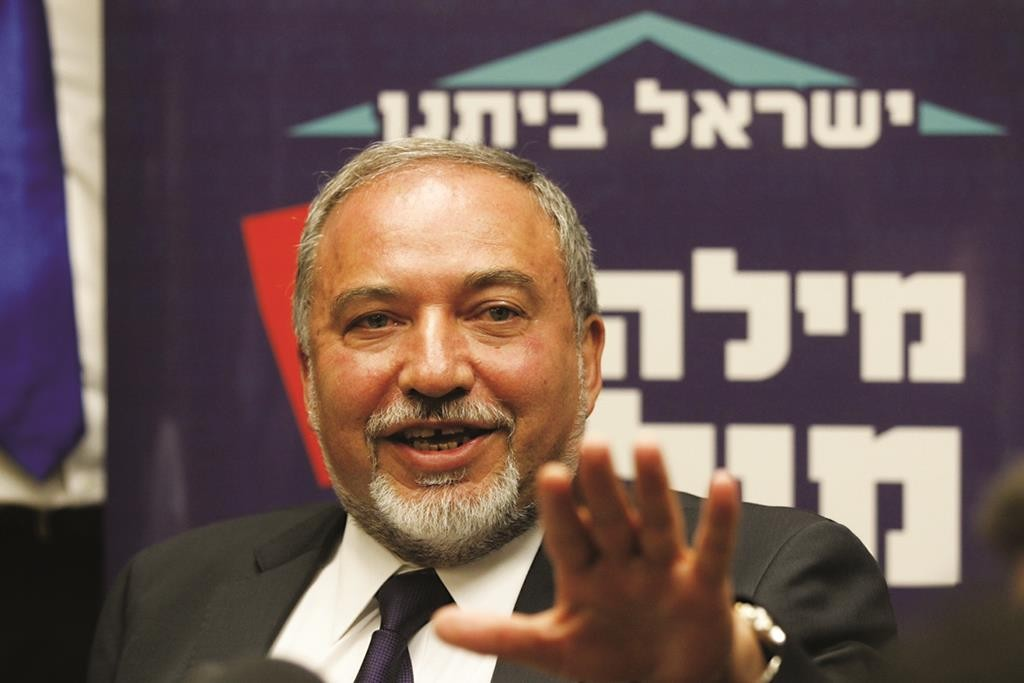 Head of the Israel Beiteinu party Avigdor Lieberman announcing his resignation on Monday.  (Miriam Alster/Flash90)