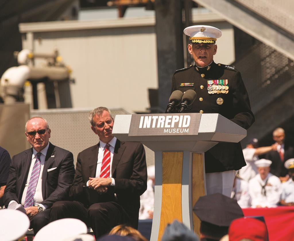 Marine Gen. John Kelly, commander of U.S. Southern Command, speaks Monday during the Memorial Day Ceremony at the Intrepid. Seated at left are Mayor Bill de Blasio and NYPD Commissioner William Bratton. (U.S. Marine Corps/Cpl. Justin T. Updegraff)