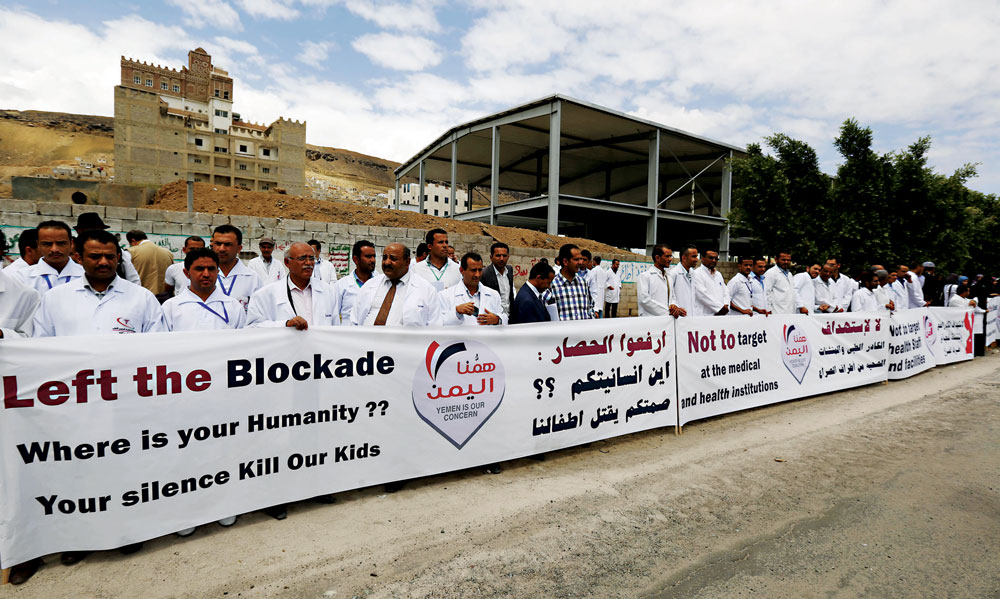 Yemeni health workers gather during a rally to demand the lifting of the blockade on Yemen, in front of the U.N. building in Sanaa, Yemen, Thursday. Saudi Arabia and the United States on Thursday announced a five-day, renewable cease-fire in Yemen's war to allow aid to reach millions of civilians caught in a humanitarian crisis from the conflict. But the truce is dependent on Iran-backed rebels and their allies also agreeing to stop fighting, they said. (AP Photo/Hani Mohammed)