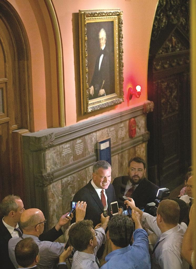 Mayor Bill de Blasio on Wednesday talks to the media outside Gov. Andrew Cuomo's office after a meeting at the state Capitol. (AP Photo/Mike Groll)