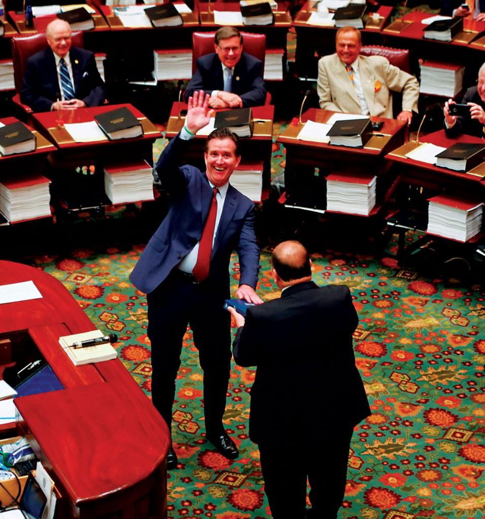New Senate Majority Leader John Flanagan waves to the gallery before being sworn in. (AP Photo/Mike Groll)
