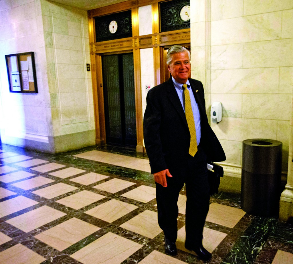 State Sen. Dean Skelos arrives Monday at his office at the Capitol. (AP Photo/Mike Groll)