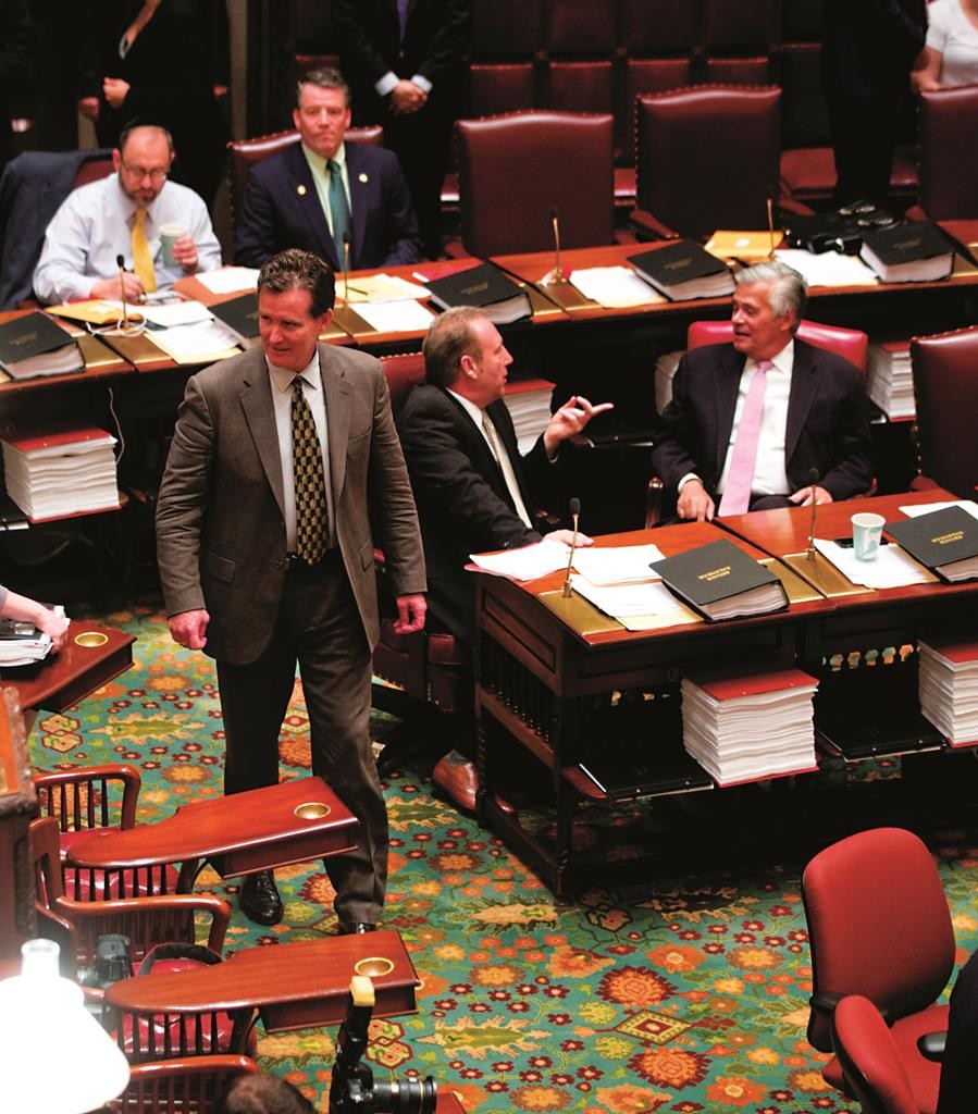 Senate Majority Leader John Flanagan in the Senate Chamber on Tuesday. Sen. Dean Skelos is on the right and Sen. Simcha Felder at left. (AP Photo/Mike Groll)