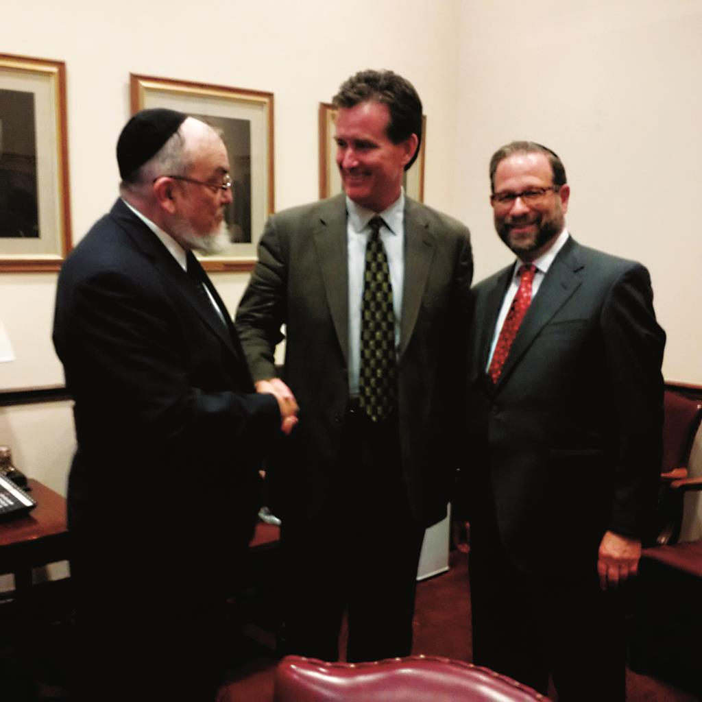 Rabbi Shmuel Lefkowitz of Agudath Israel shakes newly installed Senate Majority Leader John Flanagan's hand last Tuesday as Leon Goldenberg looks on. (Courtesy of Leon Goldenberg)
