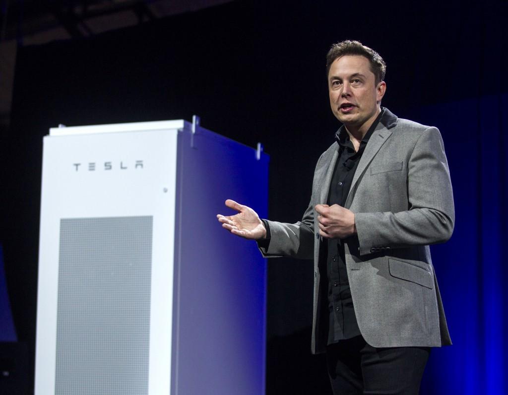 Tesla CEO Elon Musk unveils the Powerpack in Hawthorne, Calif., on Thursday, April 30, 2015. (AP Photo/Ringo H.W. Chiu)