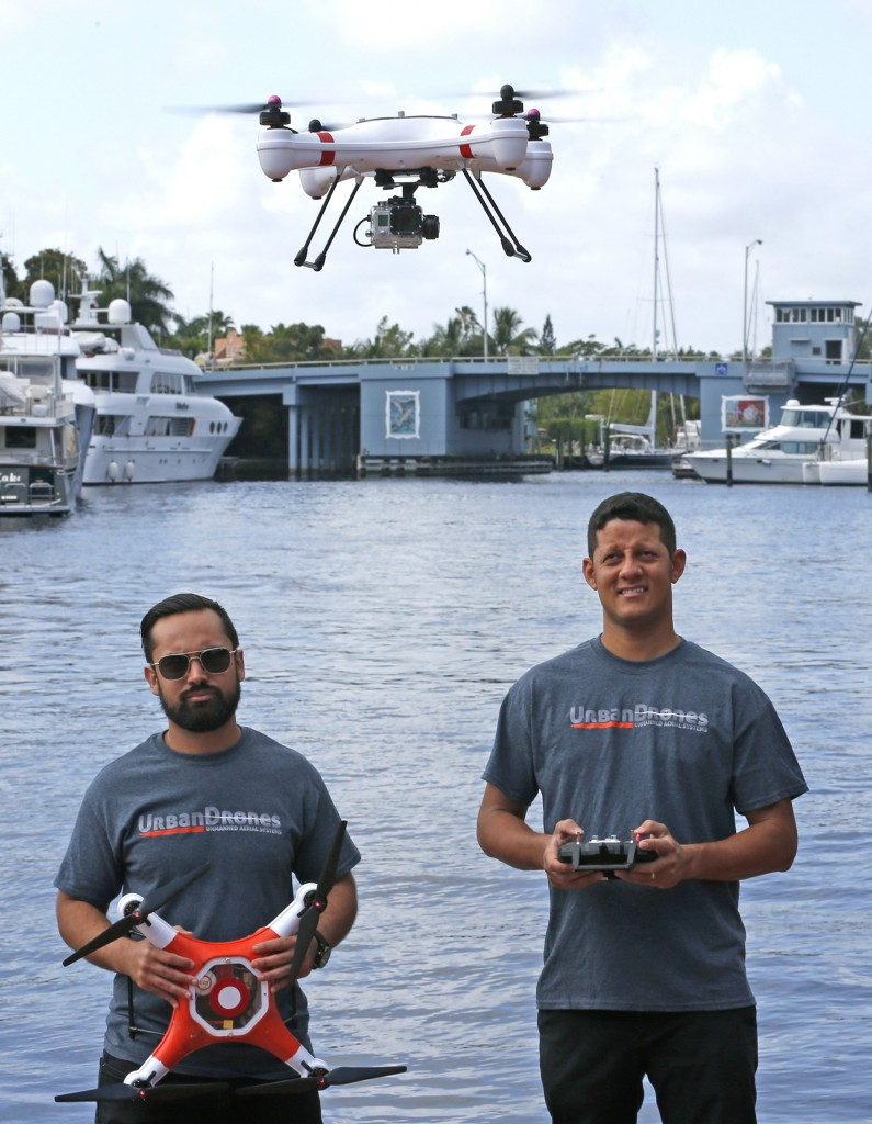 Ryan Perez and Alex Rodrigues of Urban Drones fly one of the waterproof drones they are manufacturing in downtown Fort Lauderdale, Fla., on April 9, 2015. (Charles Trainor Jr./Miami Herald/TNS)