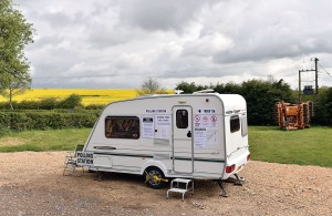 A caravan which is being used as a polling station on Grange Farm in Garthorpe, England, Thursday. (Joe Giddens / PA via AP)