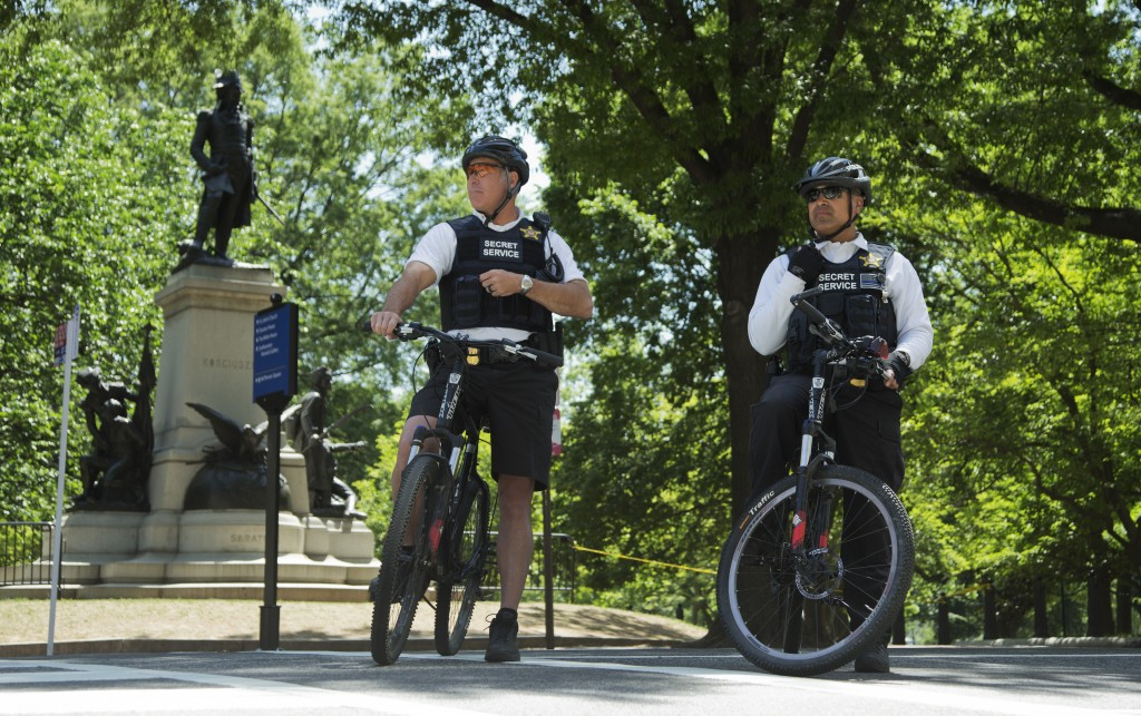 Uniformed Secret Service Police officers stand watch at Lafayette Park near the White House in Washington, Thursday, during a lockdown. A federal law enforcement official says a man has been arrested after trying to launch a drone outside the White House fence.  (AP Photo/Manuel Balce Ceneta)