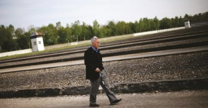Ben Lesser, 87, walks through a stone field in the Dachau Nazi concentration camp memorial in Dachau, Germany.  (AP Photo/Matthias Schrader)