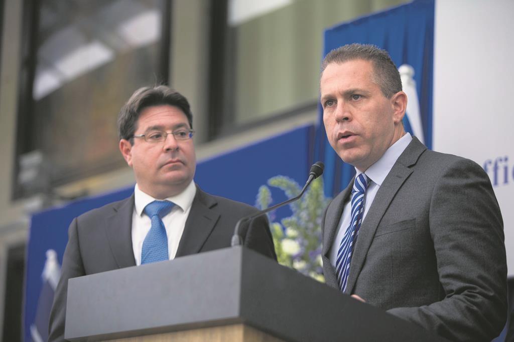 Likud MK Gilad Erdan (R), with Ofir Akunis (L). (Yonatan Sindel/Flash90)
