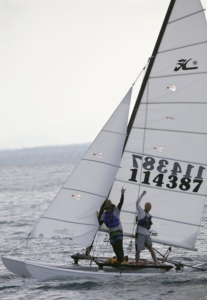 U.S. competitors wave from their catamaran during the Havana challenge race May 16. Several small sailboats that raced across the Caribbean Sea from Key West began arriving in Havana. (REUTERS/Enrique de la Osa)