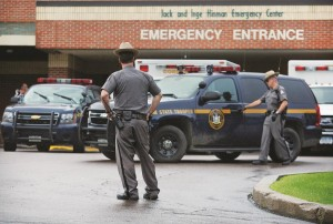 Law enforcement officers stands outside Alice Hyde Medical Center in Malone, N.Y., on Sunday, where David Sweat was taken after being shot and captured. (Jason Hunter/Watertown Daily Times via AP)