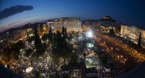 Protesters attend an anti-austerity rally in front of the parliament building in Athens, Greece, Monday. (REUTERS/Marko Djurica)