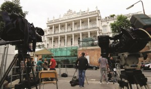 Journalists wait in front of Palais Coburg, in Vienna, Austria, where closed-door nuclear talks with Iran are taking place. (AP Photo/Ronald Zak)