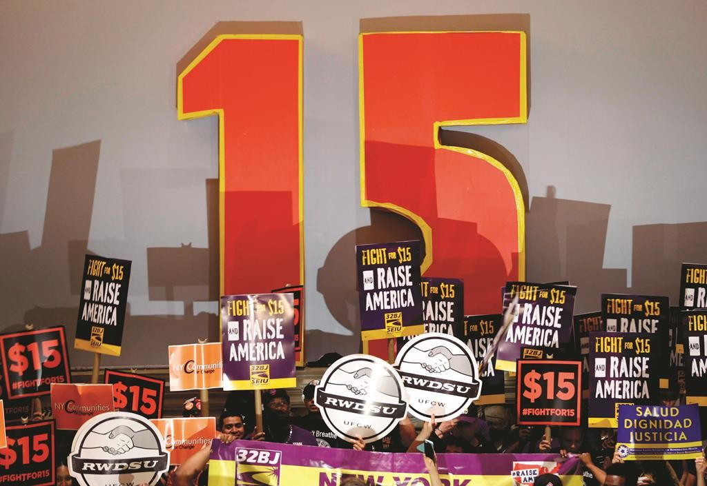 Demonstrators rally for a $15 minimum wage before a meeting of the wage board in New York Monday June 15. (AP Photo/Seth Wenig)