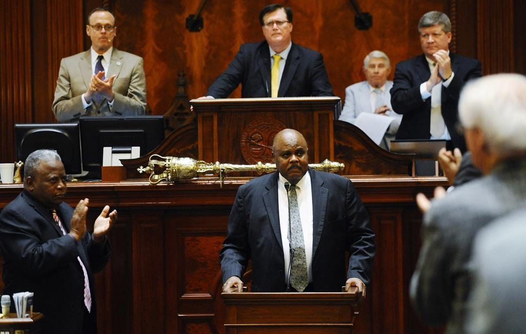 Rep. Joe Neal, D-Richland, receives a standing ovation after speaking during a special session of the state legislature at the South Carolina Statehouse, Tuesday, in Columbia, S.C.  (AP Photo/Rainier Ehrhardt)