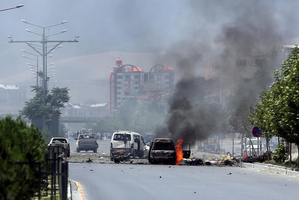 Fire and smoke rise at the site of a suicide attack staged by Taliban terrorists in front of the Parliament, in Kabul, Afghanistan, Monday. (AP Photo/Massoud Hossaini)