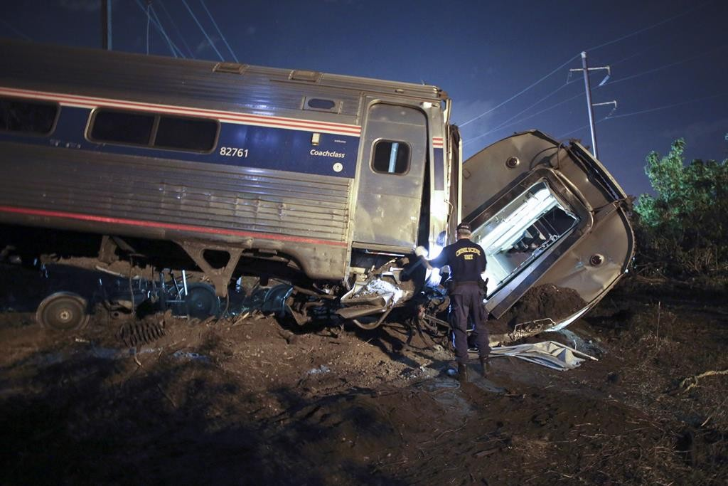 Emergency personnel work the scene of the deadly train wreck, Tuesday, May 12, in Philadelphia. (AP Photo/ Joseph Kaczmarek)