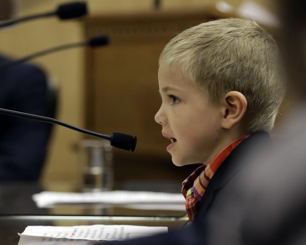 Rhett Krawitt, 6, who could not be vaccinated while he was being treated for leukemia, speaks to lawmakers about approval of a measure requiring California schoolchildren to be vaccinated during a hearing in Sacramento, Calif. (AP Photo/Rich Pedroncelli)