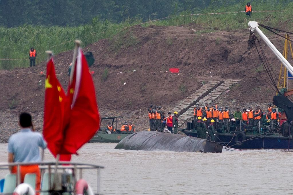 Rescuers work on the capsized ship on the Yangtze River in China's Hubei province, Wednesday. (AP Photo/Andy Wong)