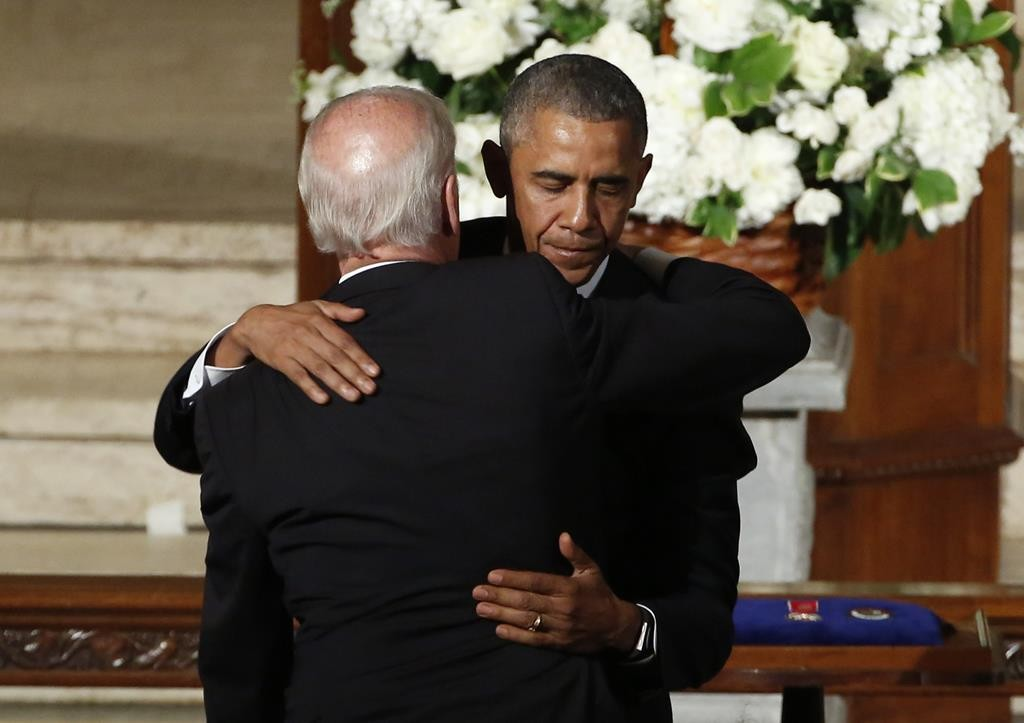 President Barack Obama embraces Vice President Joe Biden during funeral services for Biden's son, Beau Biden, Saturday, in Wilmington, Del.  (Yuri Gripas/Pool Photo via AP)