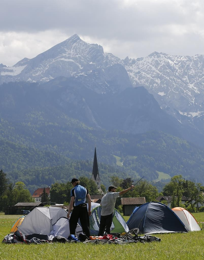 G7 opponents set up tents in a camp on the field near the Loisach river in the outskirts of Garmisch-Partenkirchen, southern Germany, Thursday. The camp is set a few miles from Elmau where the G7 leaders will meet. (REUTERS/Wolfgang Rattay)