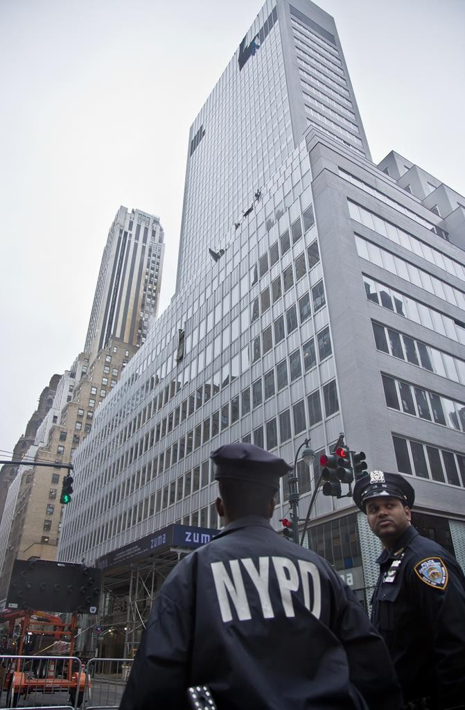 Police on Monday guard a closed-off area around a hi-rise at 261 Madison Avenue in the aftermath of a crane accident. (AP Photo/Bebeto Matthews)