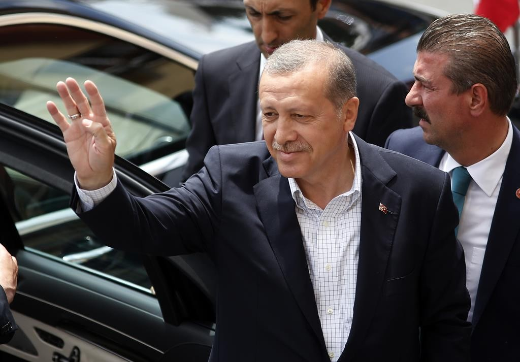 In this Sunday, June 7, photo, Turkey's President Recep Tayyip Erdogan waves to supporters after voting at a polling station in Istanbul, Turkey.  (AP Photo/Emrah Gurel)