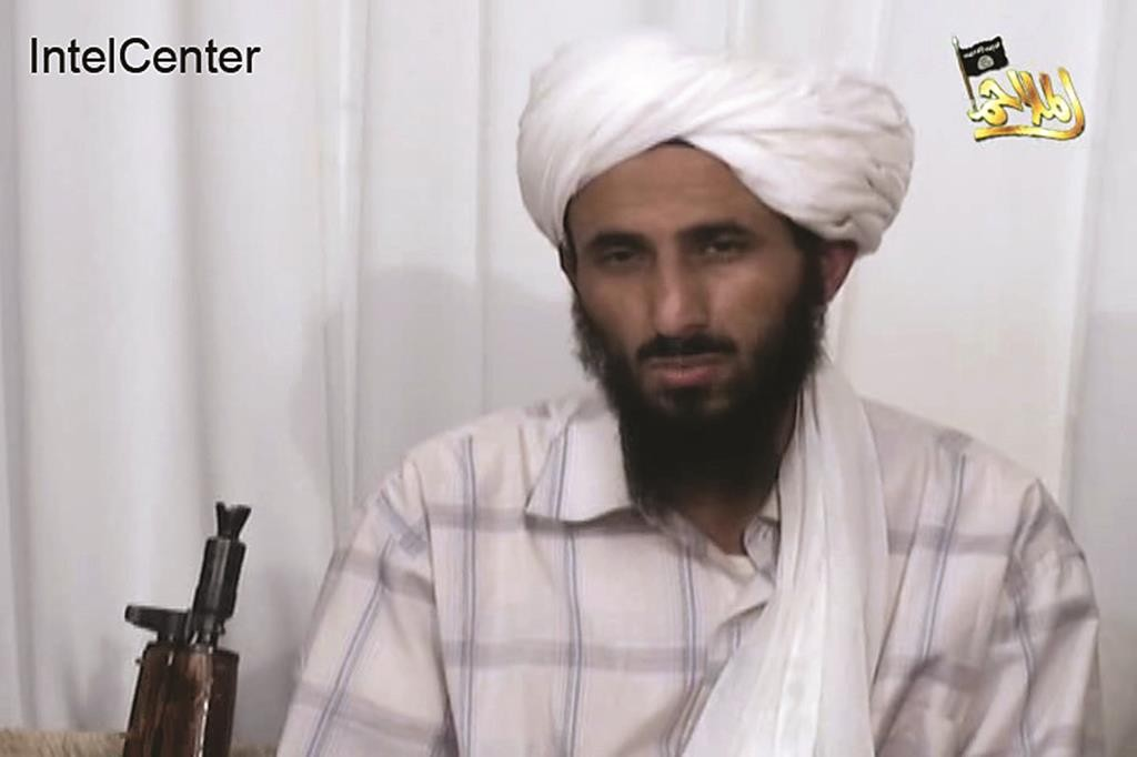 This image from video released Jan. 23, 2009, by al-Malahim Media Foundation and provided by IntelCenter on Dec. 30, 2009, shows the leader of Al-Qaida in the Arabian Peninsula, identified by the IntelCenter as Nasir al-Wahishi, in Yemen. (IntelCenter via AP, File)