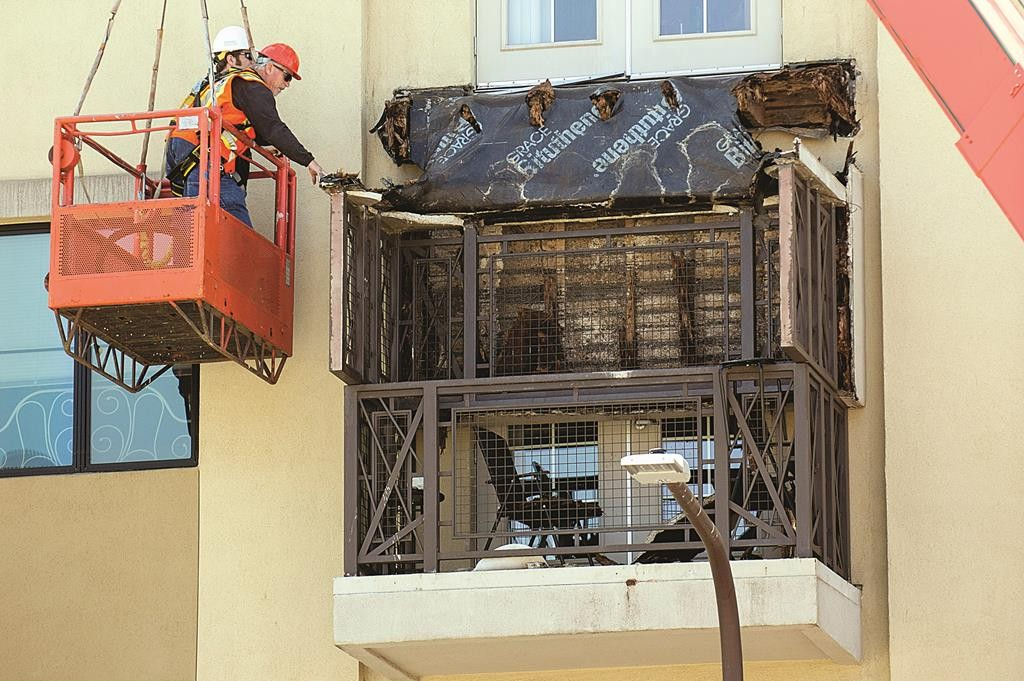 Workers examine a balcony that collapsed in Berkeley, Calif., Tuesday. (AP Photo/Noah Berger)