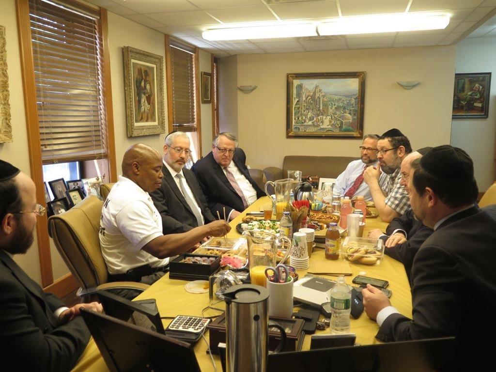 Borough President Eric Adams (L) speaks on Sunday at Leon Goldenberg's office in Flatbush to members of the Flatbush Jewish Community Coalition. (Flatbush Jewish Community Coalition)