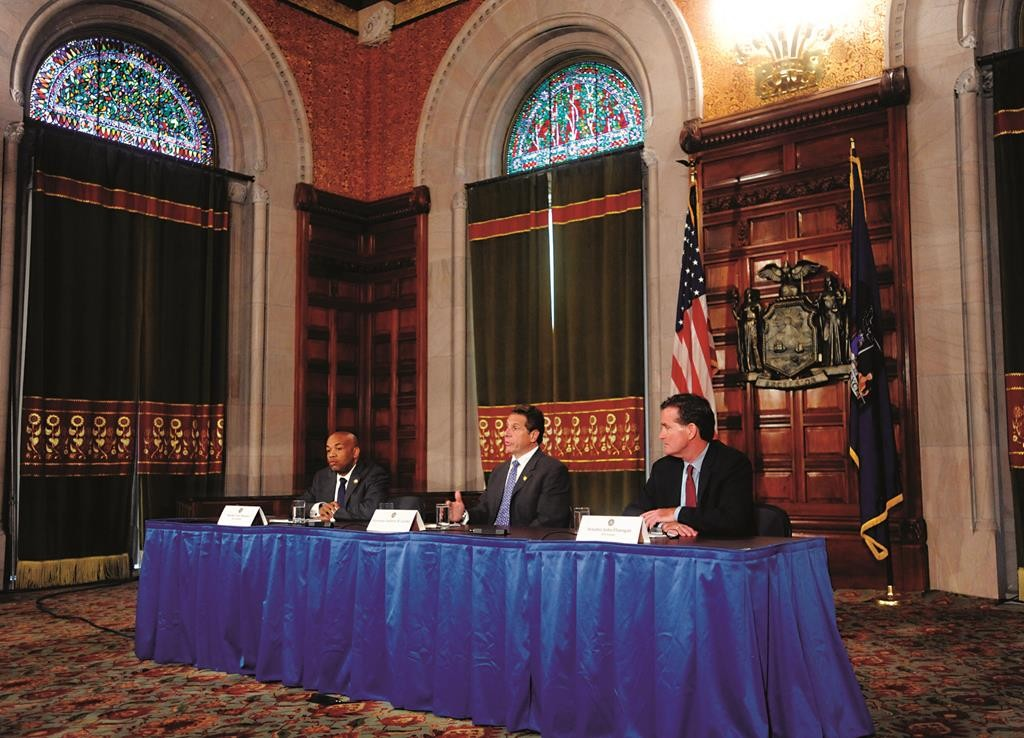 Gov. Andrew Cuomo (C) on Tuesday in a news conference with Assembly Speaker Carl Heastie (L) and Senate Majority Leader John Flanagan (R) at the Capitol in Albany. (AP Photo/Tim Roske)