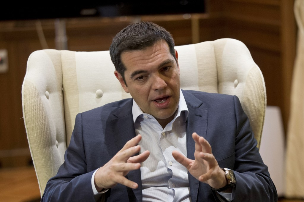 Greek Prime Minister Alexis Tsipras during a meeting with Stavros Theodorakis, leader of the political party To Potami (The River) at his office in central Athens on Tuesday, June 16. (AP Photo/Petros Giannakouris)