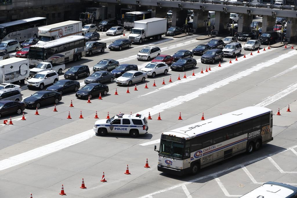 Traffic builds up on Wednesday outside the Lincoln Tunnel after a crash inside. (AP Photo/Julio Cortez)
