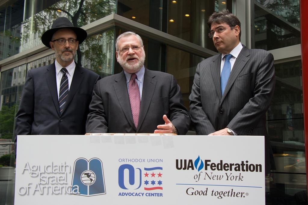 L-R: Rabbi Chaim Dovid Zwiebel of the Agudah, Allen Fagin of the OU, and Eric Goldstein of UJA on Monday attend a rally in Manhattan in support of private school tuition aid. (Courtesy of the Orthodox Union)