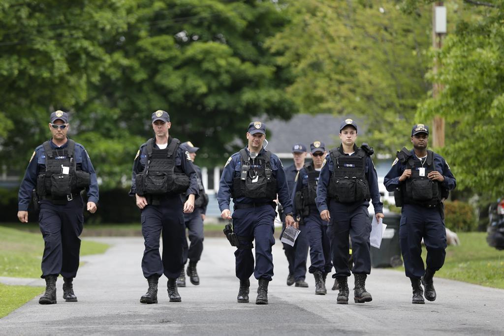 Law enforcement officials on Wednesday search near the border of Dannemora, N.Y. (AP Photo/Seth Wenig)