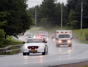Police on Sunday escort an ambulance carrying convicted murderer David Sweat shortly after his capture. (AP Photo/Mike Groll)